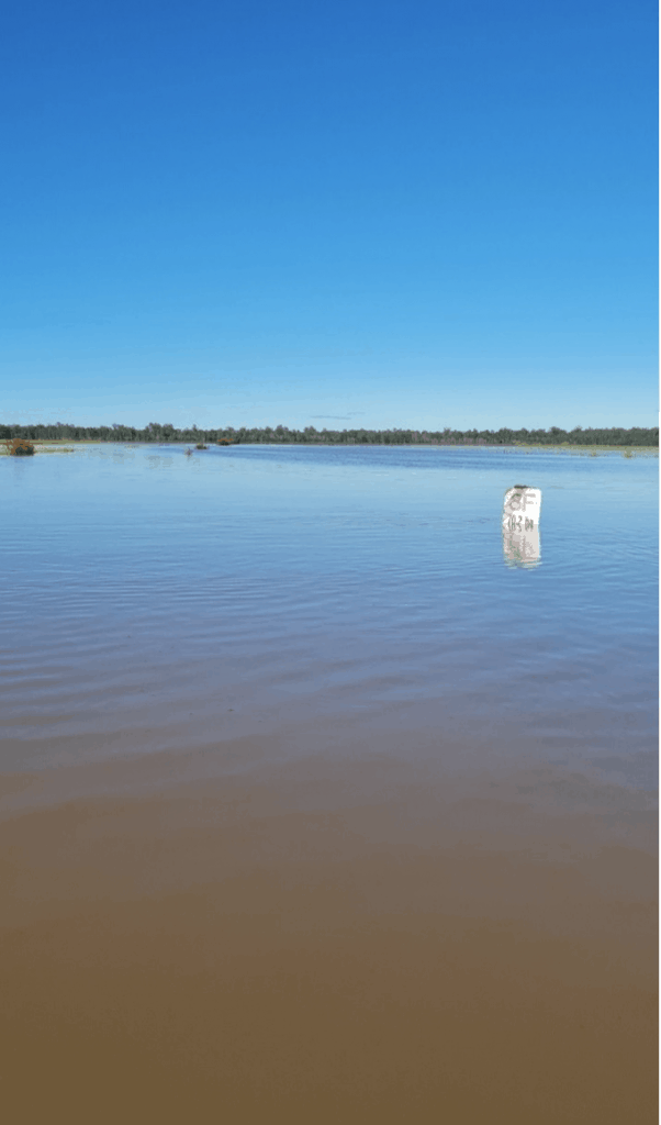 Flooded road, 3F sign under water